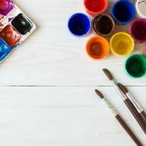 Painting set: brushes, paints, watercolor, acrylic paint on a wh